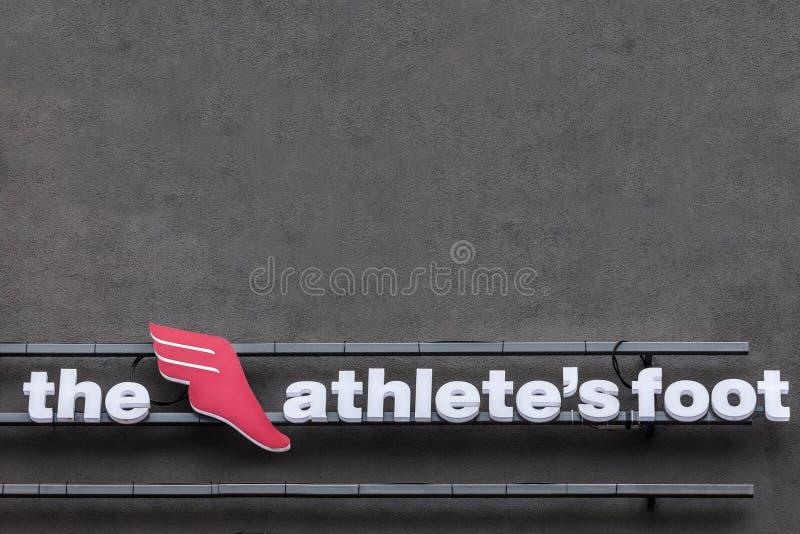 Логотип ноги ` s Athelete на их главном магазине для Белграда Также как TAF, это швейцарский глобальный воодушевленный розничный  стоковые фотографии rf