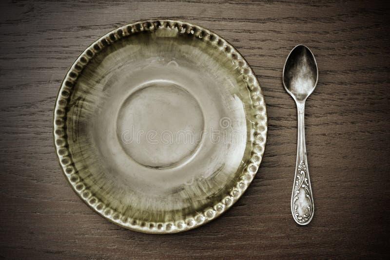 ложка плиты десерта стоковое изображение rf