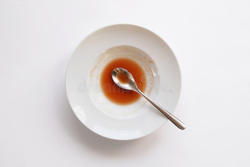 ложка супа плиты остатков стоковая фотография rf