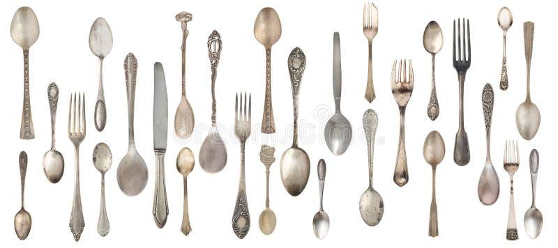 Ложки, вилки и нож собрания винтажные изолированные на белой предпосылке стоковое фото rf