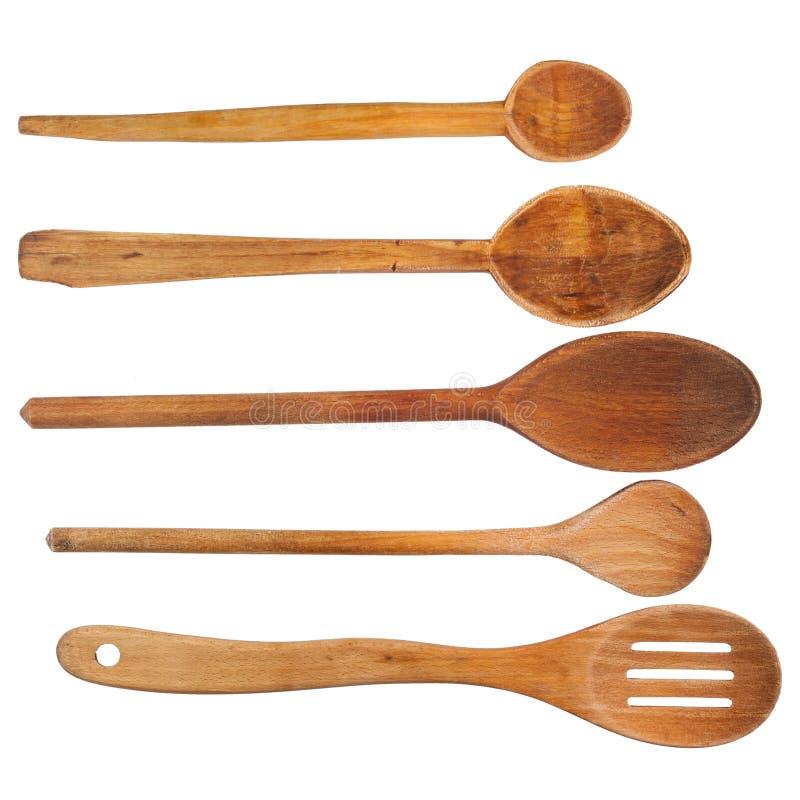 Ложки кухни деревянные изолированные на белизне стоковая фотография rf