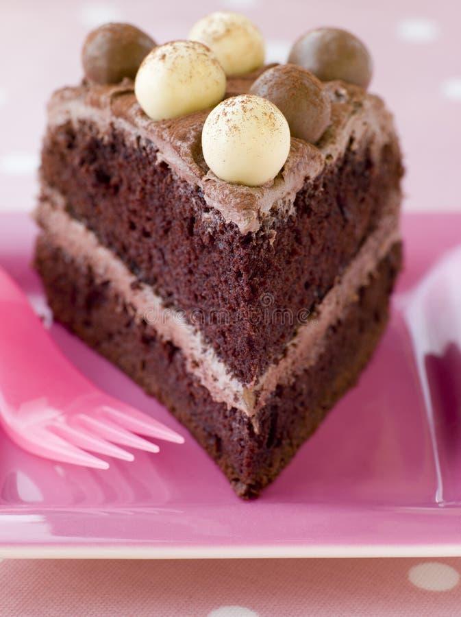 ломтик malteser шоколада торта стоковые изображения