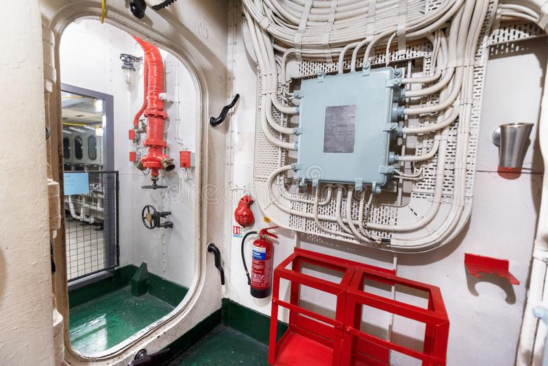 Лондон, Великобритания - 13-ое мая 2019: Интерьер музея военного корабля HMS Белфаста, увидел действие во время Второй Мировой Во стоковые изображения rf