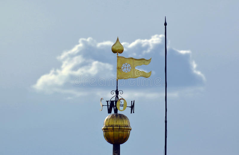 Лопасть погоды в форме флага стоковое изображение