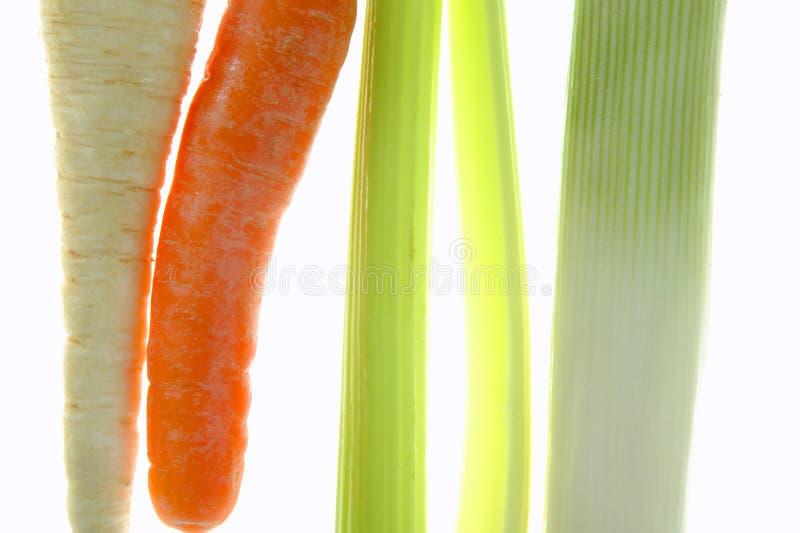 лук-порей сельдерея моркови над прозрачной белизной стоковое фото