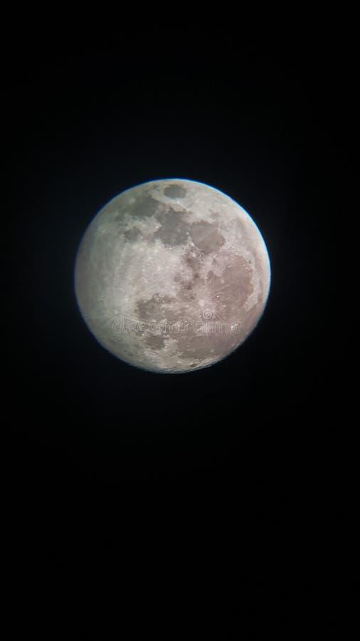 Луна на черной предпосылке неба стоковое изображение