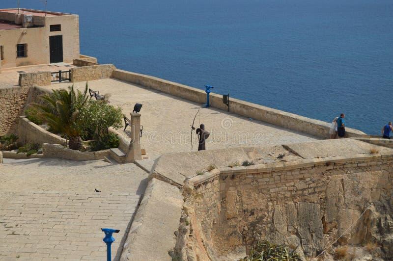 Лучник защищая туристов стоковое изображение