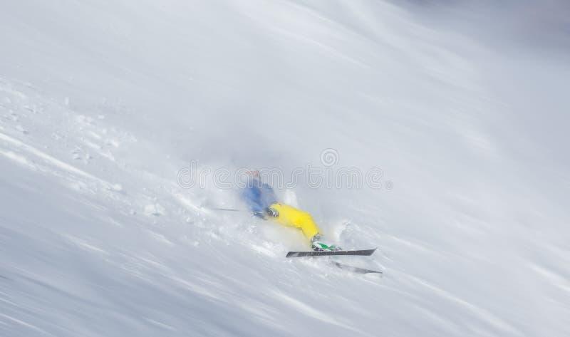 Лыжник падая на наклон стоковые фотографии rf