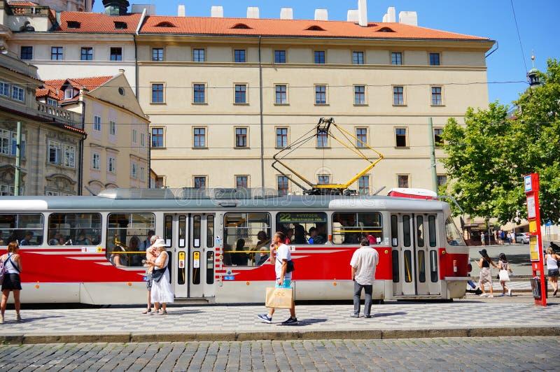 Люди и трамваи стоковые фото