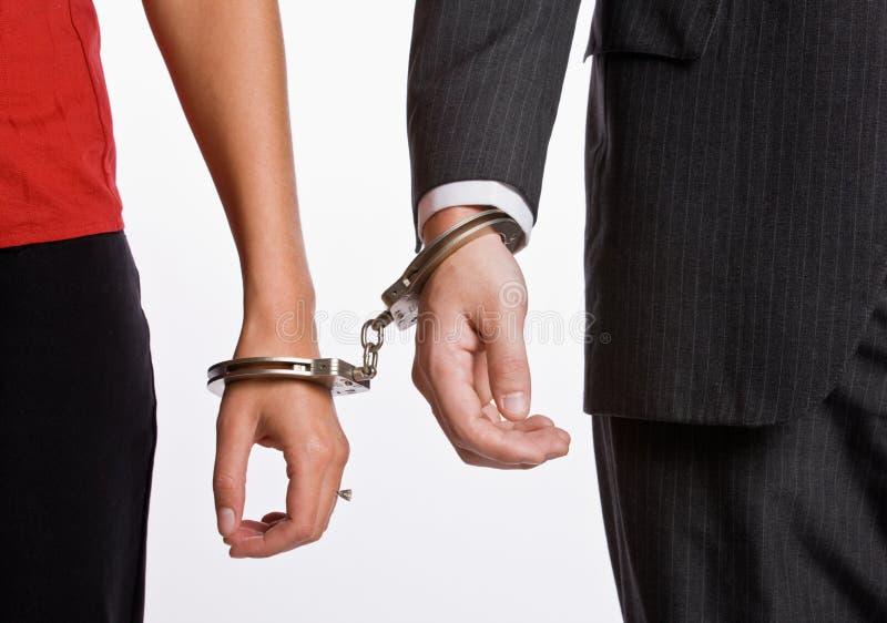 люди надеванные наручники делом совместно стоковая фотография rf