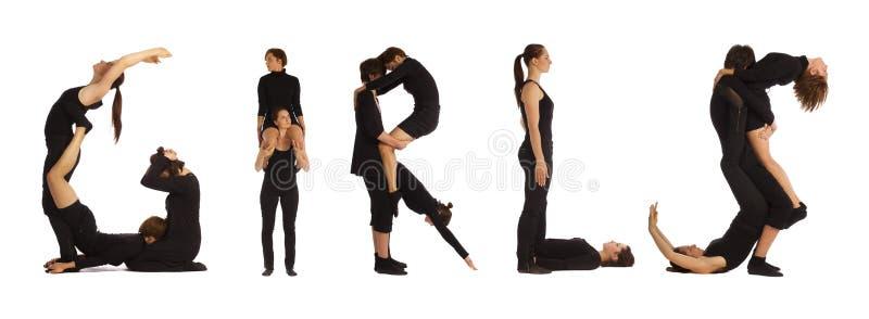 Люди одетьнные чернотой формируя слово ДЕВУШОК стоковое изображение rf