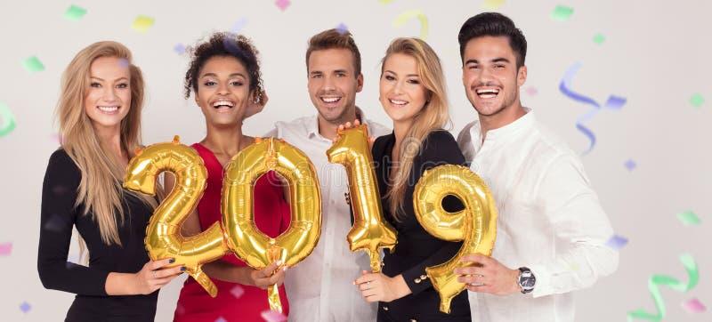 Люди партии празднуя канун Новых Годов стоковая фотография rf