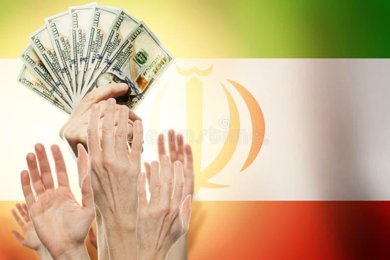Люди поднимая руки с долларами и флаг Иран на предпосылке Патриотическая концепция стоковое изображение rf