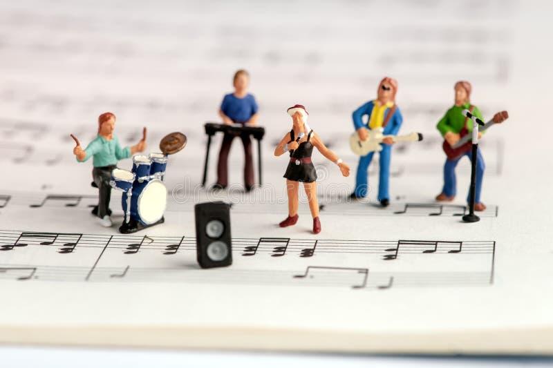 Люди рок-группы миниатюрные стоковые изображения