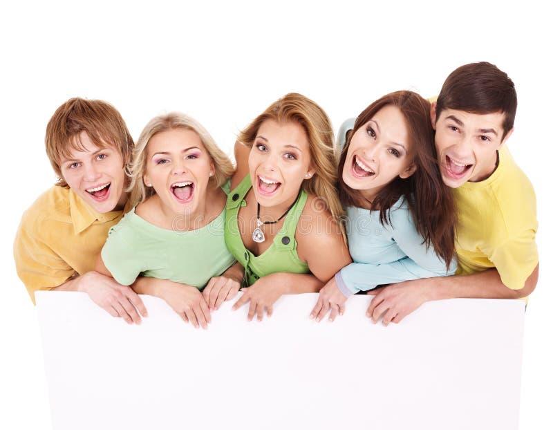 люди удерживания группы знамени счастливые стоковые изображения rf