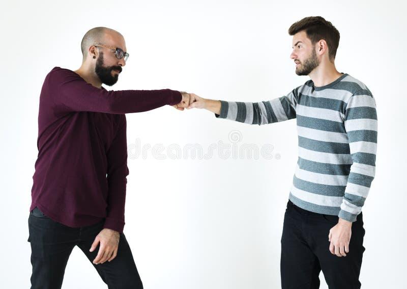Люди bumping их кулаки совместно стоковые фотографии rf