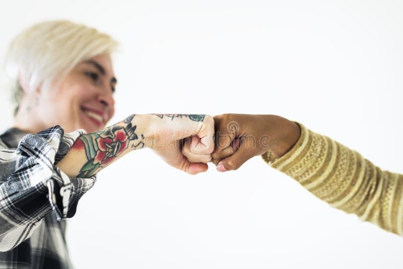 Люди bumping их кулаки совместно стоковое фото rf