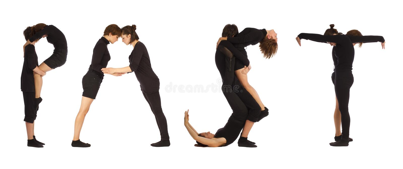 Люди одетые чернотой формируя ПРОШЛОЕ слово стоковые изображения rf
