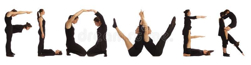 Люди одетые чернотой формируя слово ЦВЕТОК стоковые фотографии rf
