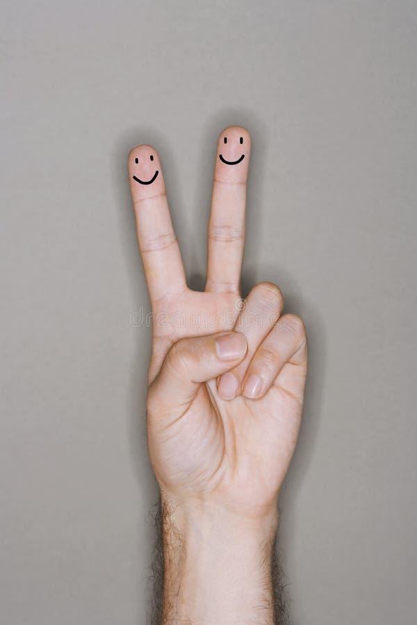 Люди пальца нарисованные на кавказской руке стоковые фото