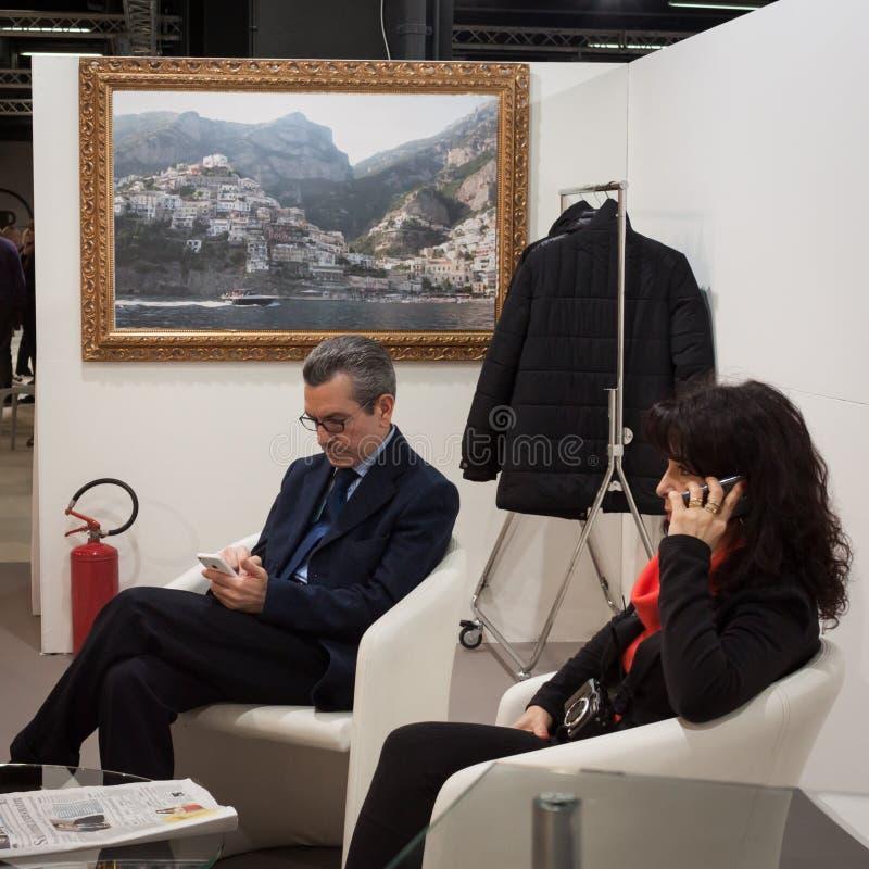 Люди работая на торговой выставке Mipap в милане, Италии стоковые фотографии rf