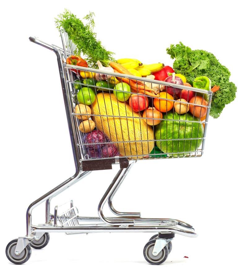 Магазинная тележкаа посещения магазина бакалеи с овощами и плодоовощами стоковое изображение
