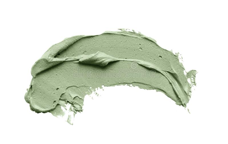 Мазок маски голубой глины лицевой на белизне изолировал предпосылку стоковые фото