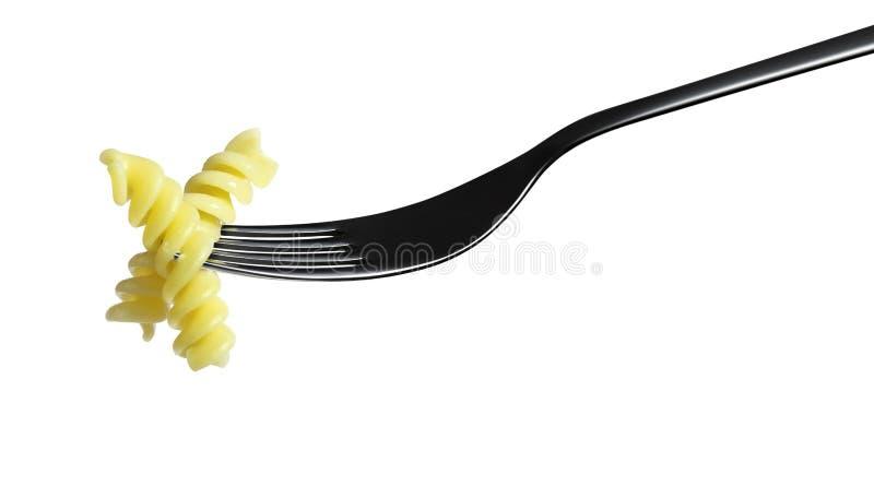Макарон fusilli макаронных изделий вилки изолированная на белизне стоковые фотографии rf