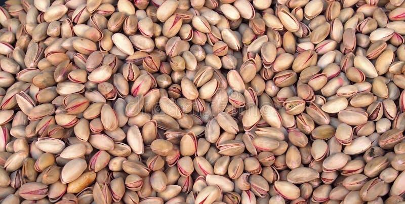 Макрос здоровых фисташек в ореховых скорлупах стоковая фотография