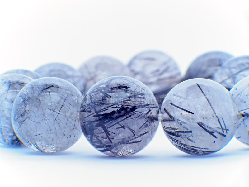 Макрос кристалла кварца кристаллов рутила стоковая фотография