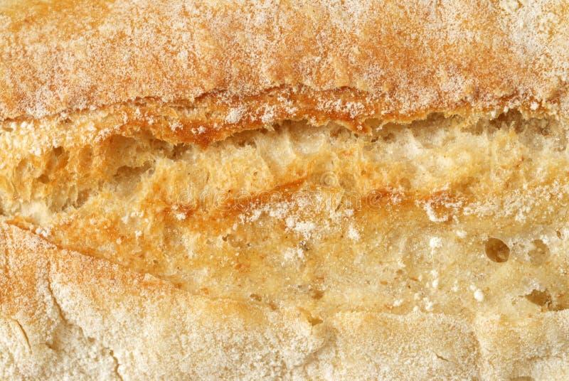 макрос хлеба покрытый коркой стоковое фото