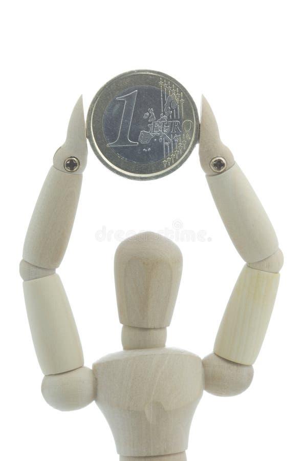 максимум монетки держит manikin вверх стоковое изображение