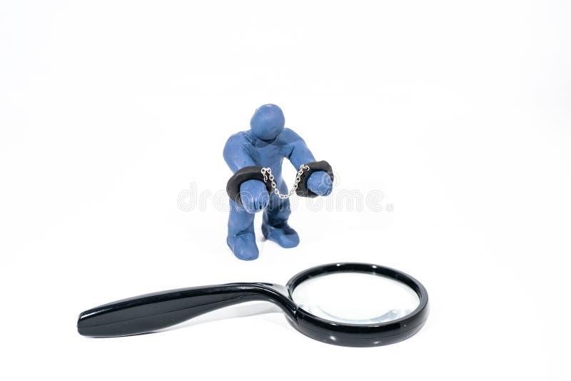 Малая голубая диаграмма в наручниках Сделанный от глины игры стоковые фото