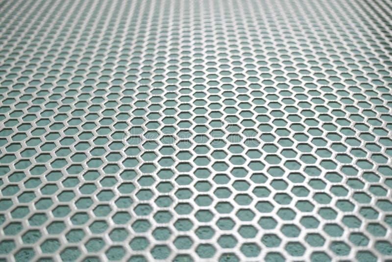Малая похожая на клетк предпосылка сетки металла клетки, шестиугольные формы стоковая фотография
