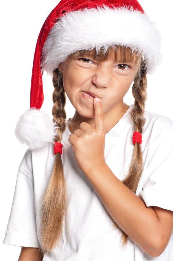 Маленькая девочка в шлеме Санта стоковое фото rf