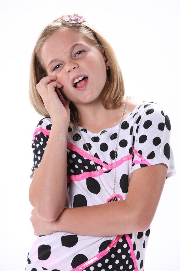 Маленькая девочка говоря на телефоне стоковая фотография rf