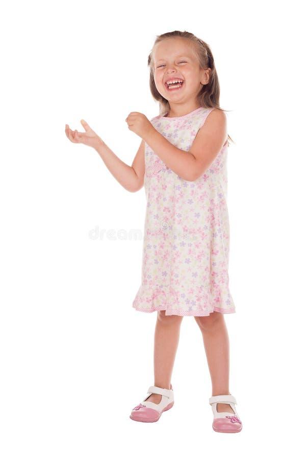 Маленькая девочка показывает что-нибыдь в руке стоковые изображения