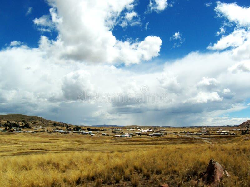 Маленький город в большом открытом поле стоковая фотография rf