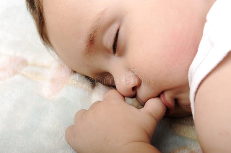 Маленький милый спать младенца стоковая фотография