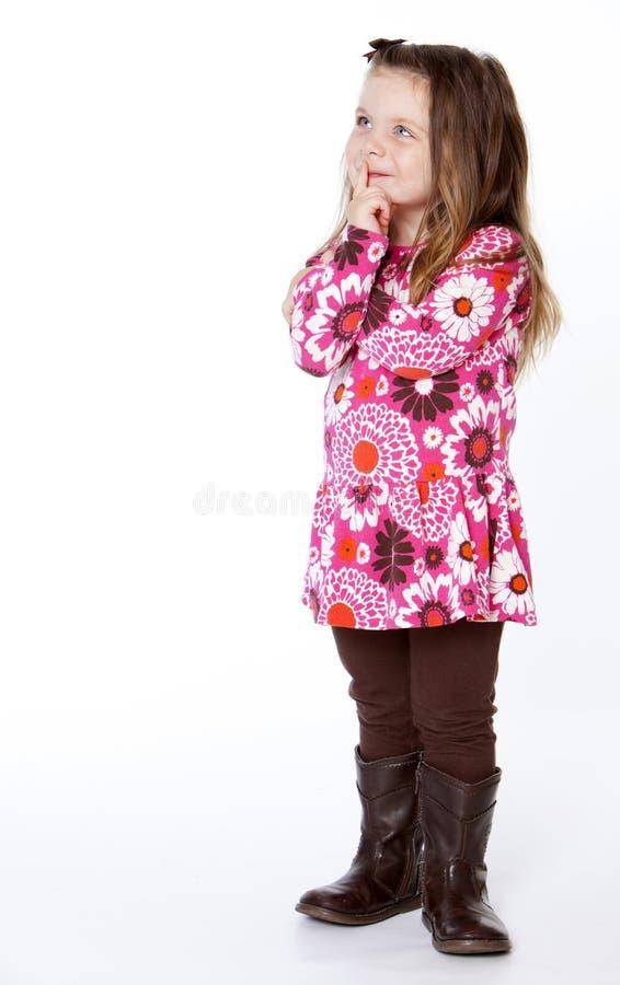 малыш девушки думая стоковое фото