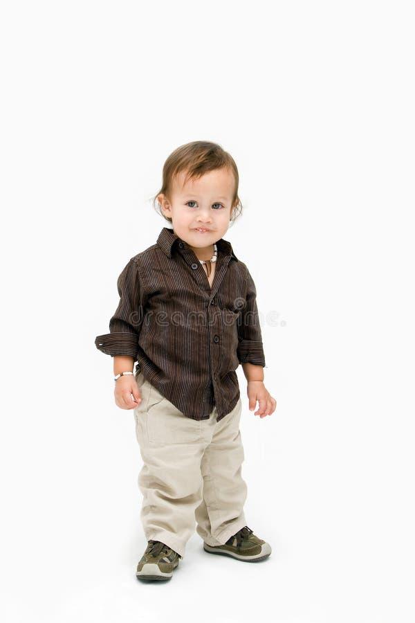 малыш мальчика стоящий стоковое изображение