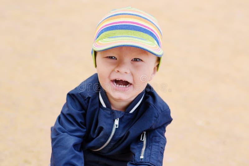 малыш мальчика счастливый стоковое фото