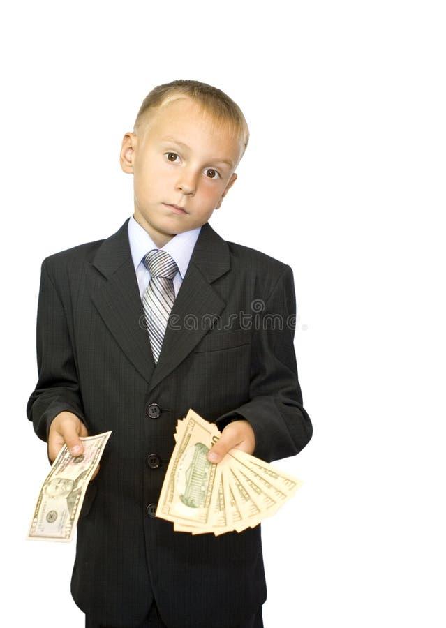 мальчик вручает его держит деньги стоковое изображение