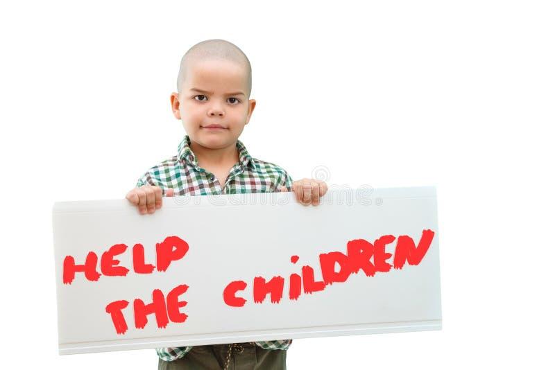 Мальчик держа знак стоковое изображение