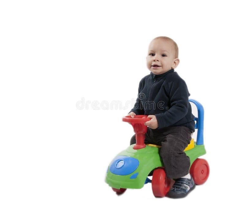 Мальчик его автомобиль игрушки стоковое фото rf