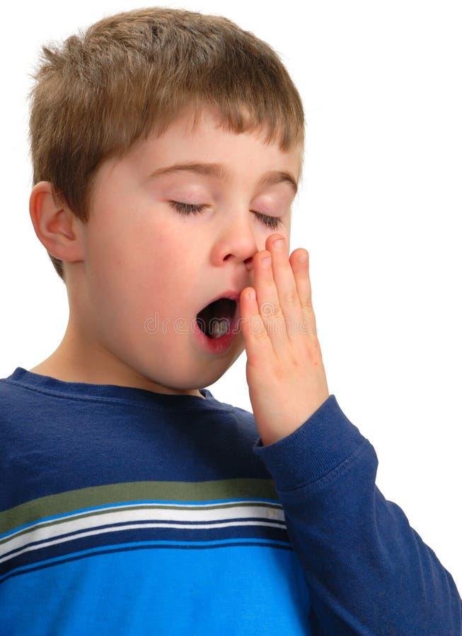мальчик зевая стоковые фото