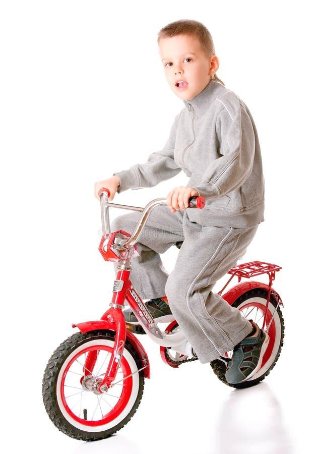 Мальчик на велосипеде стоковое фото