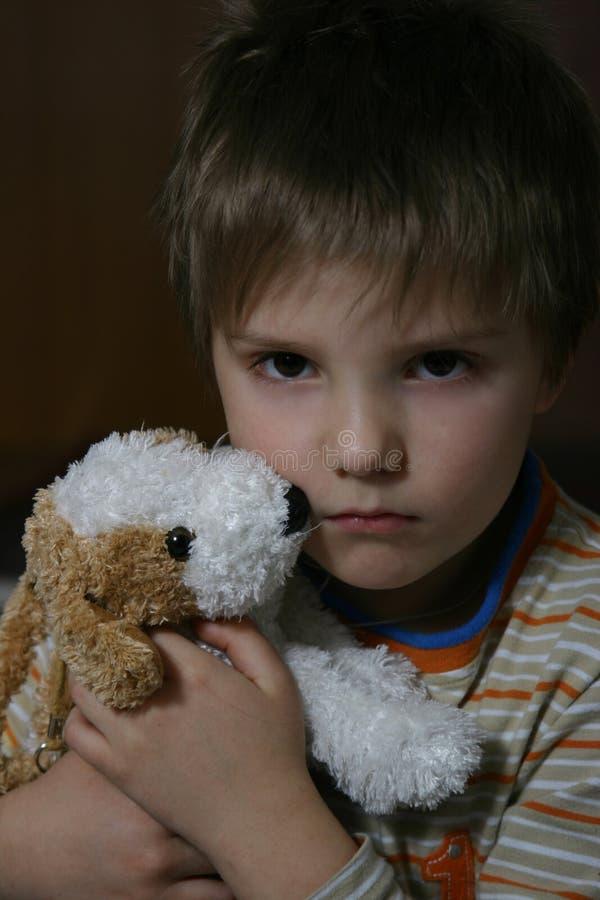 мальчик несчастный стоковое фото