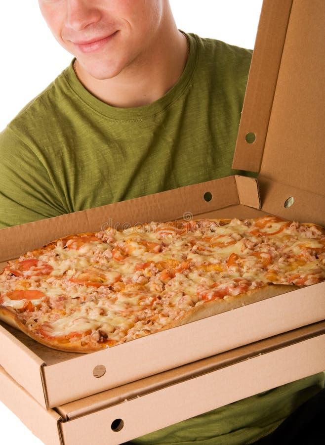 Мальчик пиццы стоковые фото