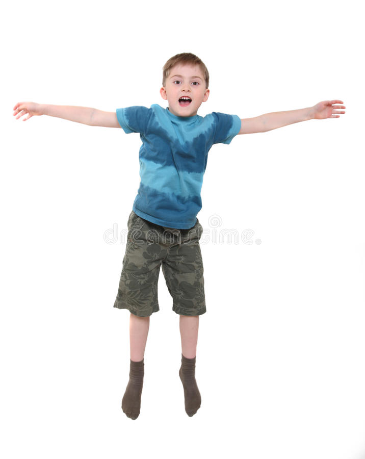 мальчик поскаканный вверх стоковые фото